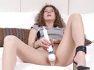 Milfs Milf Pantyhose video: Canadian milf Janice puts her massager to work