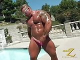 Muscle stud by the pool