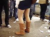 tan pantyhose skirt and brown boots candid