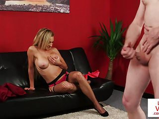 British Stockings Voyeur video: Busty babe instructs male sub wank till cum
