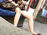 Milf showing panty in train