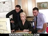 Two guys seduce blonde mature woman