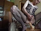 LanaTuls caged in a chastity crossdressed Riding a big dildo