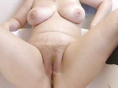 Close-up hairy pussy peeing and rubbing at the same time 1-Homemade Amateur Video