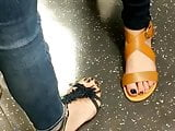 Candid feet - hot girls on Tube train