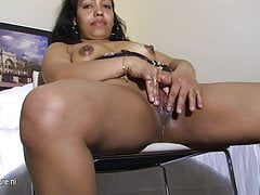 Amateur Latin old housewife loves to get wet