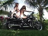 2 girls revving motorcycle in boots