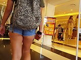 Candid voyeur thick ass teen in booty shorts shopping