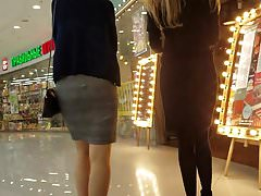 Two girls asses in skirts (left or right?)