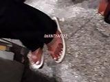 Co worker ebony feet in flip flops