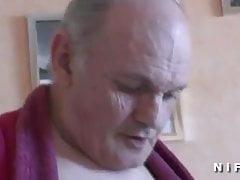 Young nurse blows an old man