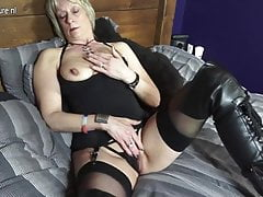 Shaved British mature mom playing with her pussy
