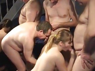 Nude women squatting and sucking cock