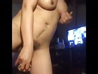 Chinese MILF playing with dildo