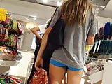 Candid voyeur hot blonde in tiny spandex shorts shopping