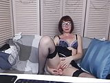 Geek in stockings and glasses uses dildo