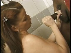 Sexy young brunette gives black stud a hand job in the shower