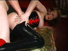 matue redhead in fetish corset gets fucked
