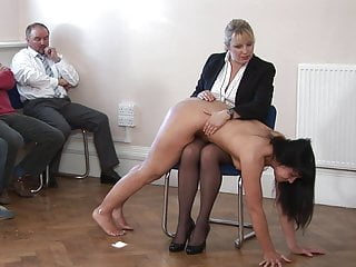 Bdsm Spanking Brunette video: Maid spanked in front of audience for stealing