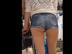 Cute teen in short denim cutoffs. With extreme close up shot