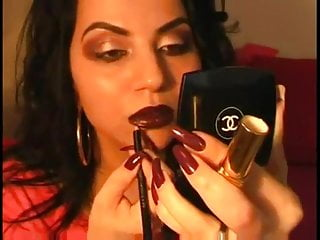 Closeup video: Lipstick with long nails