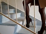 Nylonin tights and heels, climb the stairs