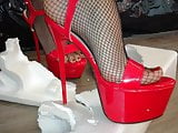 Lady L crush white box with sexy red high heels.