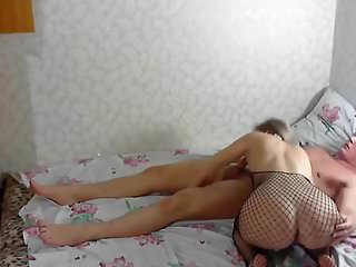 .Sex with a Russian girl in a mesh dress.