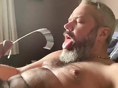 handsome grey bearded guy trying to cum in his mouth