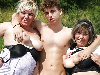 Hardcore Outdoor Handjob video: Horny Grandmas Take Hitchhiker for a Ride