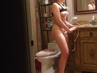 girl is watched wanking in the bathroom