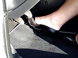 Reving the car in black High Heels
