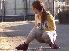 Japanese Girl Caught Pissing On Street