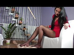 Nylon- and bootsfootjob by sexy girl