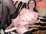 Brunette toys and fingers her juicy pussy to a creamy orgasm