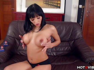 She fingers her wet shaved pussy...