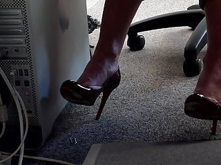 dangling her red Louboutin under desk part 2