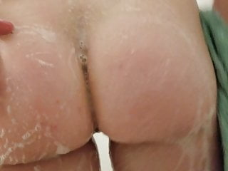 The wife soaping in the shower