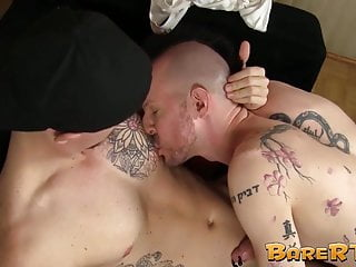 Tattooed studs making out and licking ass before bareback