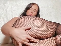 Sexy brunette with big tits fingers pussy