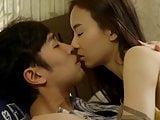 Asian couple in bedroom
