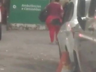 big ass walking in them red tights lol