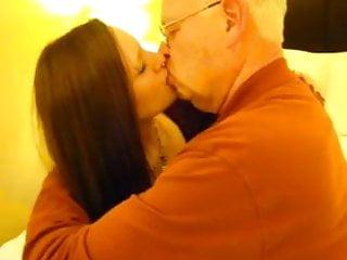 Hot woman kissing a 82 year...