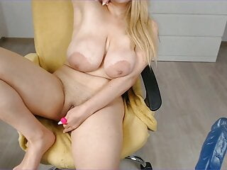 Milf with big and natural tits caresses her pussy