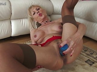 Blonde British granny getting wet