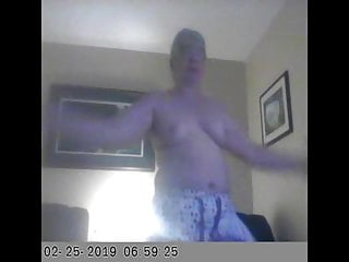 Unaware wife topless exercise