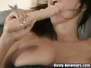 The big dildo is so easily sliding deeply inside the pussy