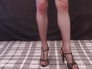 Slutty leather skirt and stripper sandals...