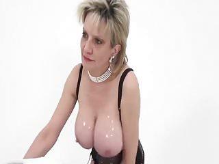 milf oils up her big tits...