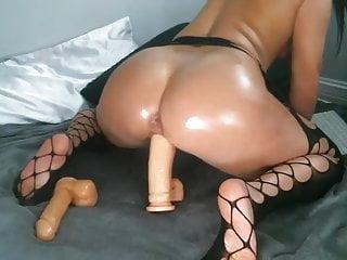 Bizarre slut rides giant dildo